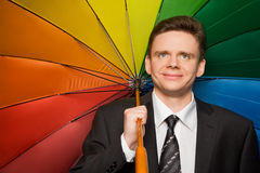 Smiling businessman in suit with umbrella Royalty Free Stock Images