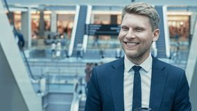Smiling businessman in a suit Royalty Free Stock Image