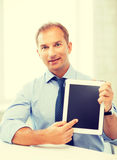 Smiling businessman with tablet pc in office Stock Photo