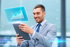 Smiling businessman with tablet pc outdoors Royalty Free Stock Photo