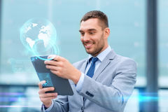 Smiling businessman with tablet pc outdoors Royalty Free Stock Photos