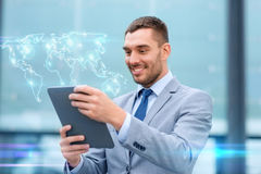 Smiling businessman with tablet pc outdoors Stock Photo