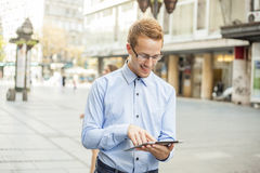 Smiling Businessman with tablet on street Stock Photos