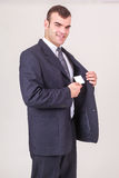 Smiling businessman takes a business card out of his jacket Royalty Free Stock Photography