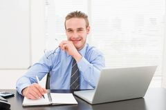 Smiling businessman taking notes on notebook Royalty Free Stock Photos