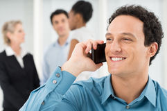 Smiling Businessman Talking On Cell Phone stock photos