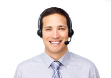 Smiling businessman talking on headset. Against a white background Stock Photo