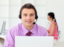 Smiling businessman talking on headset. In the office Stock Photo