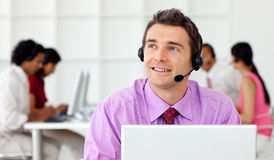 Smiling businessman talking on headset. In the office Stock Photos