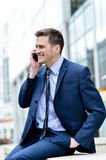 Smiling businessman talking in his mobile phone Royalty Free Stock Image