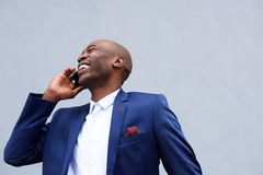 Smiling businessman talking on mobile phone Royalty Free Stock Images
