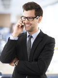 Smiling businessman talking on a mobile phone. Stock Image