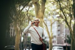 Businessman talking over mobile phone while commuting to office Royalty Free Stock Photo