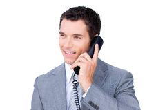 Smiling businessman talking on phone. Against a white background Royalty Free Stock Image
