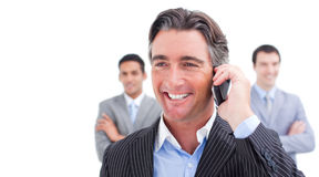 Smiling businessman talking on phone Stock Photography