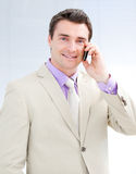 Smiling businessman talking on phone Stock Images