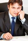 Smiling businessman talking on phone Royalty Free Stock Photos