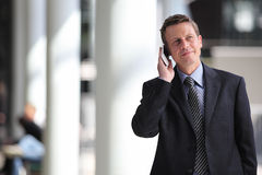 Smiling businessman talking on the phone during a business travel Stock Photography