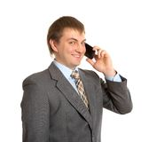Smiling businessman talking by phone Stock Images