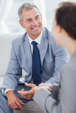 Smiling businessman talking to his workmate Royalty Free Stock Image
