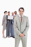 Smiling businessman with team behind him Royalty Free Stock Photos