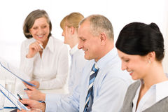 Smiling businessman during team meeting Stock Photo