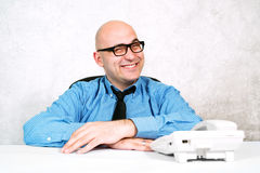 Smiling businessman with telephone Stock Image