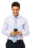 Smiling Businessman Text Messaging On Smart Phone Stock Photo
