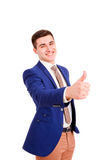 Smiling businessman with thumb up Royalty Free Stock Image
