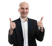 Smiling businessman with thumb up Stock Images