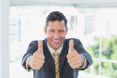Smiling businessman with thumbs up Stock Image