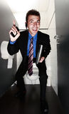 Smiling businessman in toilet Royalty Free Stock Images