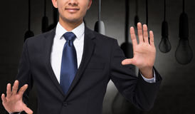 Smiling businessman touching. Composite image of smiling businessman touching Royalty Free Stock Photo