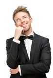 Smiling businessman touching face Royalty Free Stock Image