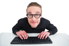 Smiling businessman typing on keyboard at desk Stock Image