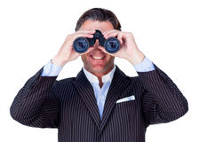 Smiling businessman using binoculars Royalty Free Stock Photo