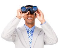 Smiling businessman using binoculars Stock Photography