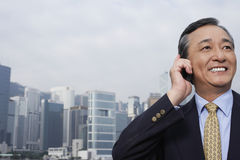 Smiling Businessman Using Cell Phone Stock Photo