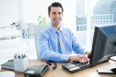 Smiling businessman using computer Royalty Free Stock Photo
