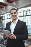 Smiling businessman using digital tablet on platform Stock Image