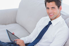 Smiling businessman using digital tablet Stock Photography