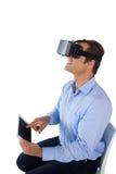 Smiling businessman using digital tablet while wearing vr glasses Stock Images