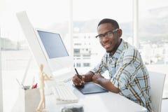 Smiling businessman using digitizer at desk Stock Photos