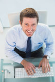 Smiling businessman using his computer Royalty Free Stock Photography