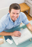 Smiling businessman using his laptop at desk Stock Images