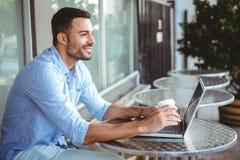 Smiling businessman using his laptop Royalty Free Stock Photo