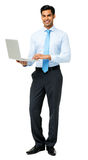 Smiling Businessman Using Laptop Royalty Free Stock Image