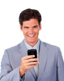 Smiling businessman using a mobile phone Stock Photography