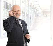 Smiling businessman using mobile phone Stock Photo