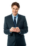 Smiling businessman using mobile phone Stock Photos
